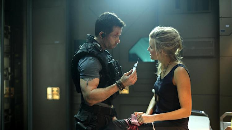 "In this film image released by Film District, Guy Pearce, left, and Maggie Grace are shown in a scene from ""Lockout."" (AP Photo/Film District)"