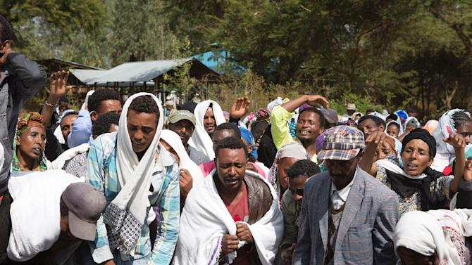 People mourn the death of alleged protester Dinka Chala who was shot dead by Ethiopian forces in Yubdo Village, about 100km from Addis Ababa, on December 17, 2015