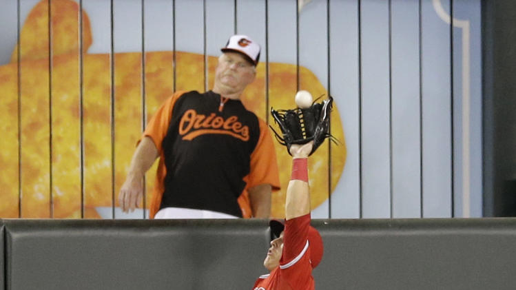 Los Angeles Angels center fielder Mike Trout leaps to catch a fly ball hit by Baltimore Orioles' Steve Pearce at the wall in the seventh inning of a baseball game, Thursday, July 31, 2014, in Baltimore. Los Angeles won 1-0 in 13 innings. (AP Photo/Patrick Semansky)