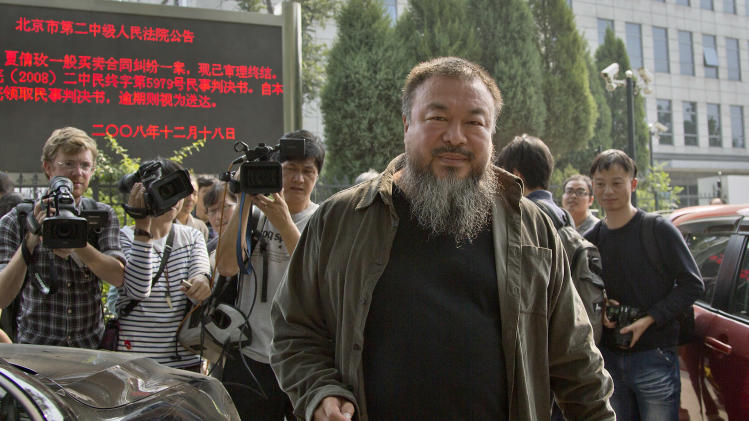 Chinese activist artist Ai Weiwei prepares to leave the Beijing No. 2 People's Intermediate Court, after attending his appeal case in Beijing Thursday, Sept. 27, 2012. Chinese authorities on Thursday rejected Ai's second appeal of a $2.4 million tax fine, meaning his design company will have to pay the penalty. (AP Photo/Andy Wong)