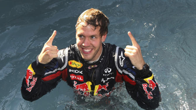 Red Bull driver Sebastian Vettel of Germany celebrates in the pool of the Red Bull paddock after he won the Monaco Formula One Grand Prix, at the Monaco racetrack, in Monaco, Sunday, May 29, 2011. Vettel profited from a large stroke of fortune to win Sunday's Monaco Grand Prix, beating Fernando Alonso and Jenson Button in a thrilling and incident-packed race that several drivers failed to finish.   (AP Photo/Claude Paris)