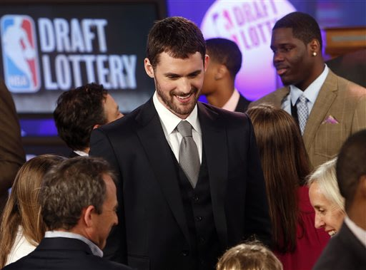 Minnesota Timberwolves' Kevin Love, center, mingles onstage before the NBA basketball draft lottery, Tuesday, May 21, 2013 in New York