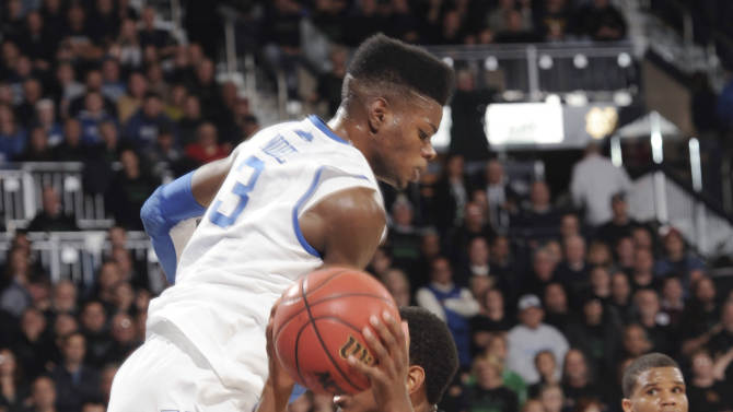 Notre Dame guard Eric Atkins, right, gets Kentucky forward Nerlens Noel up in the air on a fake late in the Notre Dame's 64-50 win in an NCAA college basketball game Thursday, Nov. 29, 2012, in South Bend, Ind. (AP Photo/Joe Raymond)