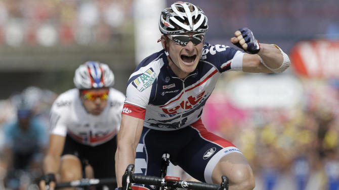 Andre Greipel of Germany crosses the finish line ahead of Edvald Boasson Hagen of Norway, left, to win the 13th stage of the Tour de France cycling race over 217 kilometers (134.8 miles) with start in Saint-Paul-Trois-Chateaux and finish in Le Cap D'Agde, France, Saturday July 14, 2012. (AP Photo/Laurent Cipriani)