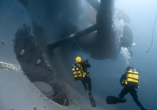 FILE In this undated file photo released by the Italian Fire Brigade, Vigili del Fuoco, Tuesday, Jan. 31, 2012, firemen scuba divers check one of the propellers of the luxury cruise ship Costa Concordia that run ashore off the Tuscany island of Isola del Giglio, Italy. A veritable treasure now lies beneath the pristine Italian waters where the massive cruise liner ran aground last month. In the chaotic evacuation of more than 4,200 people from the Costa Concordia, passengers and crew abandoned almost everything on board: jewels, cash, champagne, antiques, 19th century Bohemian crystal glassware, thousands of art objects and even 300-year-old woodcut prints by a Japanese master. (AP Photo/Vigili del Fuoco)