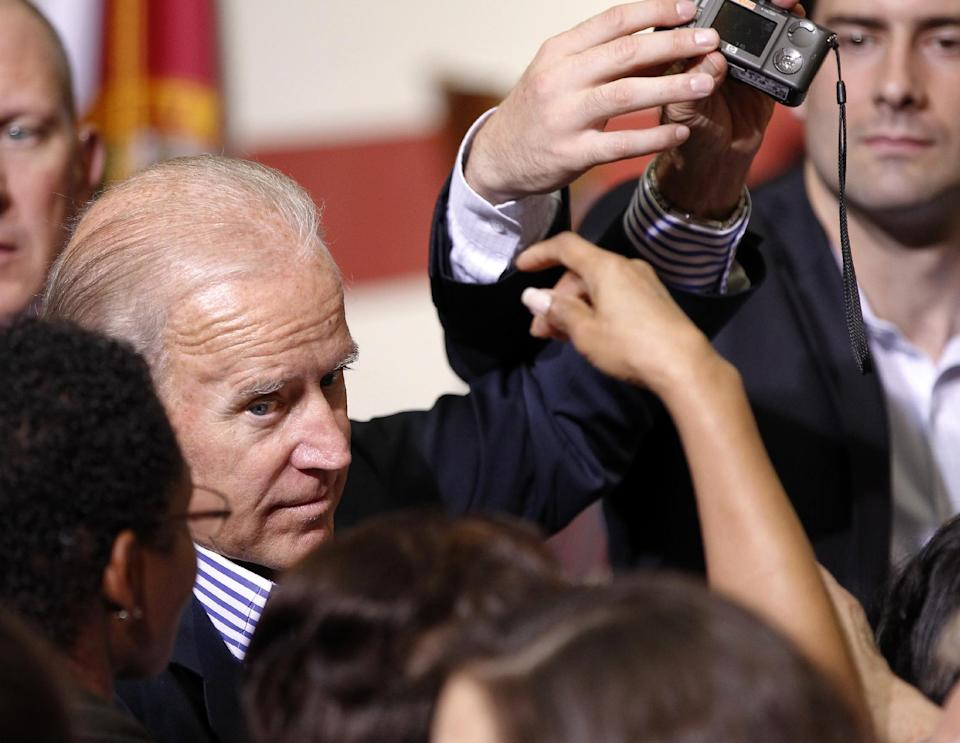 Vice President Joe Biden greets supporters during a campaign event at the Century Village Clubhouse in Boca Raton, Fla., Friday, Sept. 28, 2012. (AP Photo/Terry Renna)