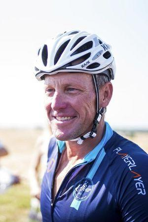 Cyclist Lance Armstrong of the US  is seen during a break as he takes part in Geoff Thomas's 'One Day Ahead' charity event during a stage of the 102nd Tour de France cycling race from Muret to Rodez