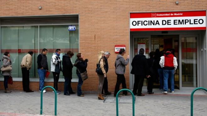 People wait to enter a Madrid unemployment office on March 4: Spain's unemployment rate is a staggering 27 percent.