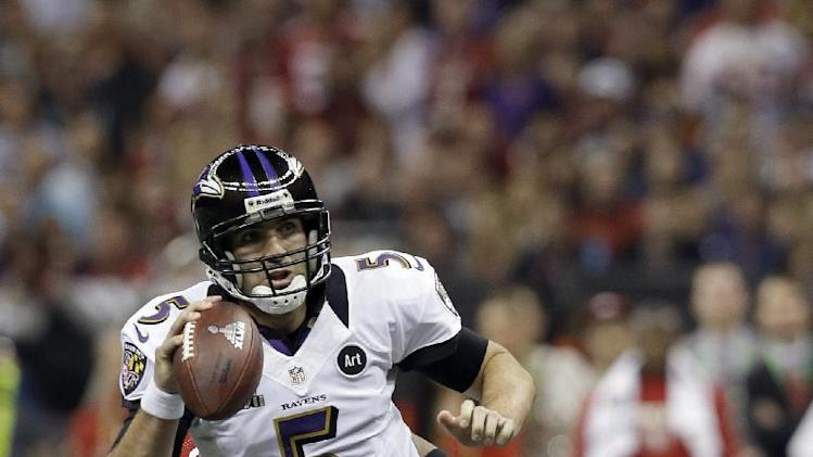 Baltimore Ravens quarterback Joe Flacco rolls out to pass against the San Francisco 49ers during the first half of the NFL Super Bowl XLVII football game, Sunday, Feb. 3, 2013, in New Orleans. (AP Photo/Dave Martin)