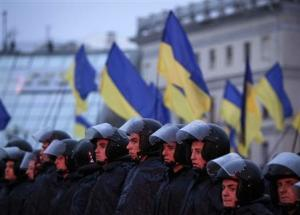 Riot police stand guard during a rally to support EU integration in central Kiev