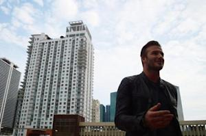 David Beckham talks to reporters at Miami Dade College in downtown Miami