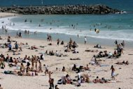 This file photo shows people at Perth&#39;s popular Cottesloe beach, in 2006. Beaches remained closed on Sunday along Australia&#39;s west coast after a fatal shark attack that has reignited debate over whether great whites should remain a protected species