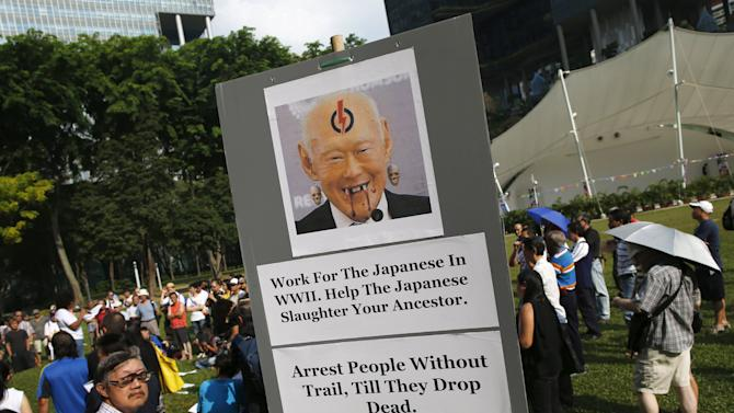 A demonstrator holds up a placard during a protest to free blogger Amos Yee, at Hong Lim Park in Singapore