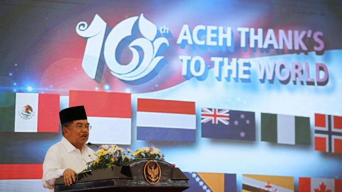Indonesia's Vice President Jusuf Kalla delivers a speech during a ceremony to commemorate 10th anniversary of the 2004 tsunami in Banda Aceh
