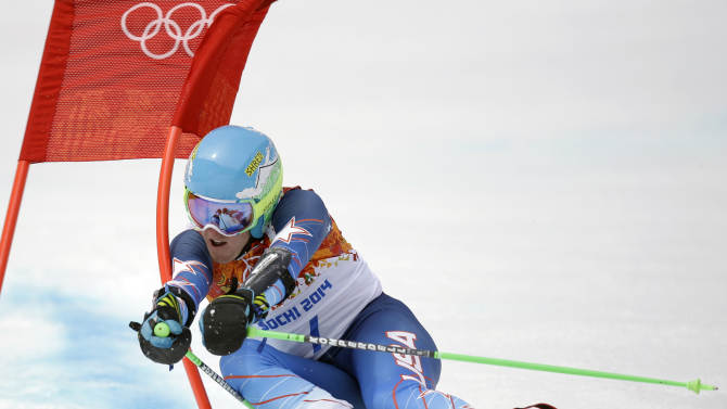 United States' Ted Ligety passes a gate in the first run of the men's giant slalom at the Sochi 2014 Winter Olympics, Wednesday, Feb. 19, 2014, in Krasnaya Polyana, Russia. (AP Photo/Luca Bruno)