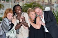 "(From left) Actress Inge Maux, actor Peter Kazungu, actress Margarethe Tiesl and Austrian director Ulrich Seidl pose during the photocall of ""Paradies: Liebe"" (Paradise: Love) at the Cannes film festival. The graphic, unflinching look at the interplay of desire, money and power among European women sex tourists and African gigolos was screened at Cannes Friday"