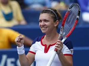 Halep of Romania reacts after defeating Kirilenko of Russia at the U.S. Open tennis championships in New York