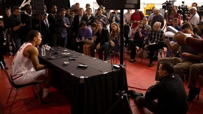 Chicago Bulls' Derrick Rose, left, speaks during the NBA basketball team's news conference, Monday, Oct. 1, 2012, in Deerfield, Ill. (AP Photo/Charles Cherney)