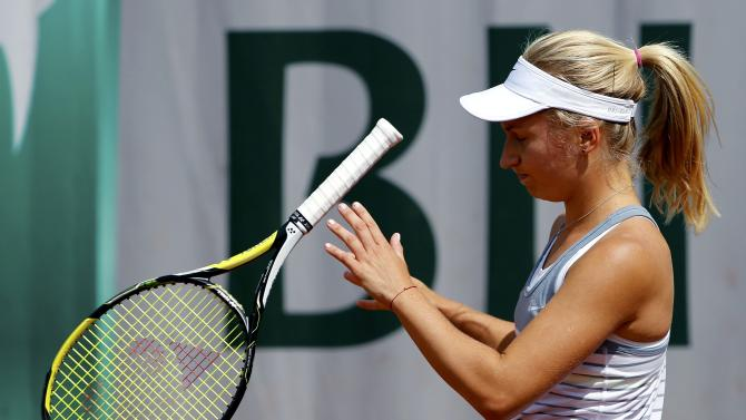 Daria Gavrilova of Australia throws her racket during the women's singles match against Sabine Lisicki of Germany at the French Open tennis tournament at the Roland Garros stadium in Paris