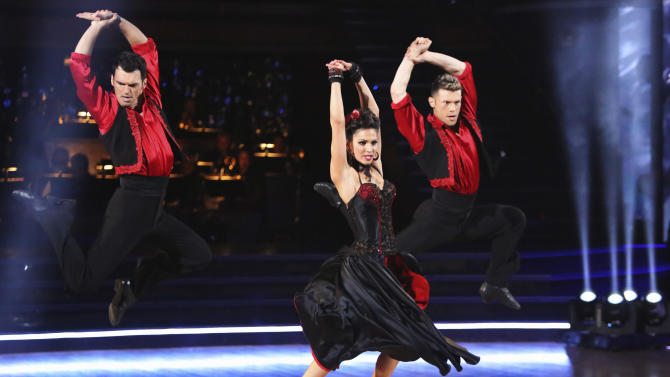 """This November 12, 2012 publicity photo released by ABC shows, from left, Tony Dovolani, Melissa Rycroft, and Henry Byalikov, during  a performance on """"Dancing with the Stars: All Stars,"""" in """"Episode 1508,""""which included two rounds of competition for the seven remaining couples, a Ballroom and Latin Trio round, on the ABC Television Network. There's no second act for celebrities on """"Dancing With the Stars."""" ABC Entertainment Chairman, Paul Lee, said Thursday, Jan. 10, 2013, that was the lesson from the past few months, when the network brought back some favorite contestants from its long-running competition series and the show fell flat. (AP Photo/ABC, Adam Taylor)"""