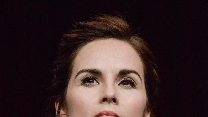 "Michelle Dockery speaks on stage during the ""Downton Abbey"" panel at the the PBS 2014 Summer TCA held at the Beverly Hilton Hotel on Tuesday, July 22, 2014, in Beverly Hills, Calif. (Photo by Richard Shotwell/Invision/AP)"
