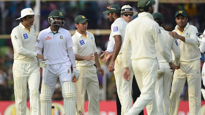 Bangladesh's Shakib Al Hasan (2nd L) shakes hands with Pakistan captain Misbah-ul-Haq (L) at close of play on the fifth and final day of the first Test match in Khulna on May 2, 2015