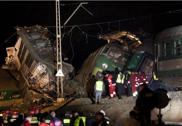 Polish emergency services work at the site of a train crash near the town of Szczechociny