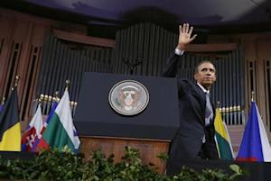 Obama waves after delivering a speech at Palais des Beaux-Arts in Brussels
