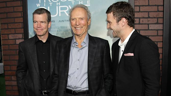 """Cast member Clint Eastwood, center, cast member Justin Timberlake, right, and director Robert Lorenz pose together at the premiere of """"Trouble With the Curve"""" at the Westwood Village Theater on Wednesday, Sept. 19, 2012, in Los Angeles. (Photo by Matt Sayles/Invision/AP)"""