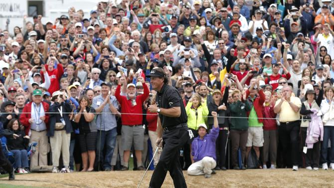 Phil Mickelson smiles after his par putt on18th green during the final round of the Waste Management Phoenix Open golf tournament, Sunday, Feb. 3, 2013, in Scottsdale, Ariz. Mickelson won the tournament with a 28 under par. (AP Photo/Matt York)