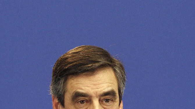 France's Prime minister Francois Fillon addresses the media, in Paris, Monday, Jan. 30, 2012. Fillon on Monday said France was slashing its forecast for economic growth this year to 0.5 percent, from the 1 percent forecast the government has stuck with since November in the face of gathering evidence of a Europe-wide recession. (AP Photo/Christophe Ena)