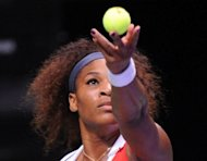 Serena Williams of USA serves to Victoria Azarenka of Belarus during the WTA Championships tennis tournament in Istanbul. Serena clinched her third win at the WTA Championships on Thursday with a 6-4, 6-4 victory over Victoria Azarenka that prevented the Belarusian from guaranteeing the end-of-year number one spot