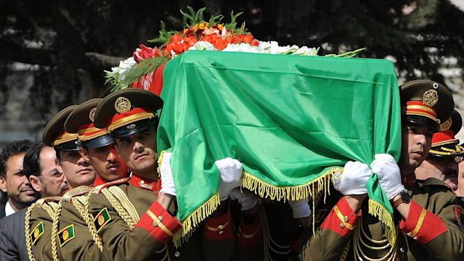 Afghan soldiers carry the coffin of slain Afghanistan High Peace Council and former President Burhanuddin Rabbani during his funeral at the Presidential Palace in Kabul on Friday Sept. 23, 2011. Afghan President Hamid Karzai vowed to continue efforts to broker a peace deal with the Taliban on September 23 as he led thousands of mourners at the funeral of his assassinated peace envoy Burhanuddin Rabbani. Kabul police deployed thousands of extra officers as part of a security lockdown designed to protect the funeral prayers being offered at the presidential palace from increasingly brazen gun and suicide attacks.  (AP Photo/Shah Marai/Pool)