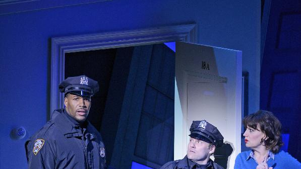 """This image released by ABC shows former NFL player Michael Strahan, left, portraying a police officer on stage with Lee A. Wilkins, center, and Beth Leavel during the matinee show of the musical """"Elf,"""" Wednesday, Dec. 5, 2012 in New York. Strahan, a co-host on the morning show """"Live! with Kelly and Michael,"""" made his Broadway debut Wednesday playing three roles in the Christmas-themed musical.  (AP Photo/Disney-ABC, Lorenzo Bevilaqua)"""