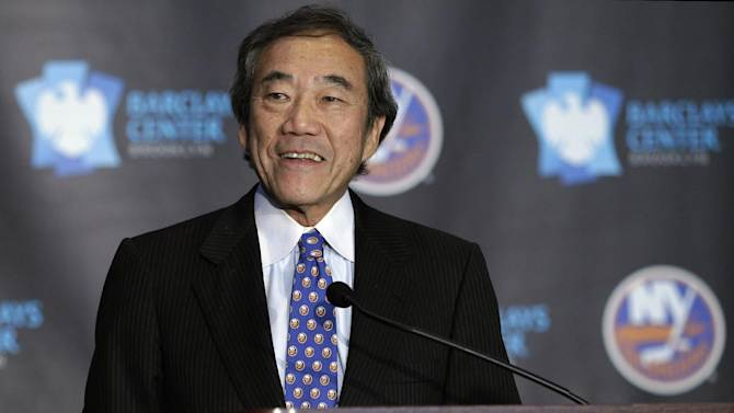 """This is an Oct. 24, 2012, file photo,  showing New York Islanders owner Charles Wang addressing the media during a press conference at Brooklyn's Barclays Center. The New York Islanders have announced that the team is being sold to a former Washington Capitals co-owner and a London-based investor. In a statement Tuesday, Aug. 19, 2014, the team says a group led by former Capitals co-owner Jon Ledecky and investor Scott Malkin has reached an agreement to buy a """"substantial"""" minority interest in the team"""