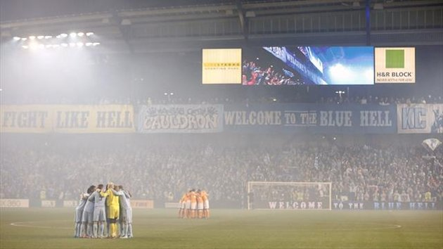 Sporting KC and the Houston Dynamo in a haze of pyrotechnic smoke prior to the Eastern Conference Semi-final at LiveStrong Sporting Park (AFP)