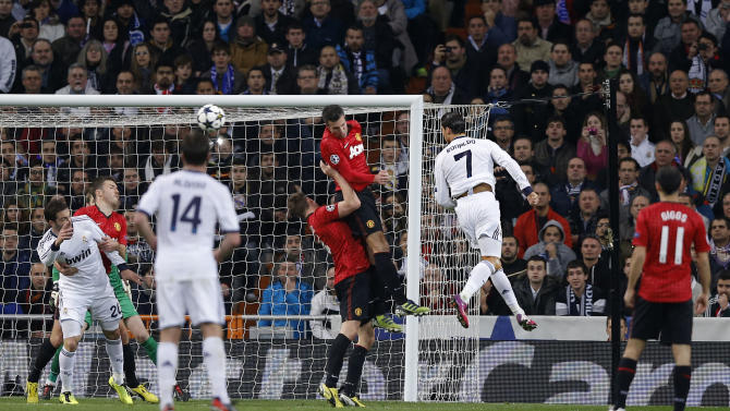 Real Madrid's Cristiano Ronaldo from Portugal heds the ball during a Champions League round of 16 first leg soccer match against Manchester United at the Santiago Bernabeu stadium in Madrid, Wednesday, Feb. 13, 2013. (AP Photo/Daniel Ochoa de Olza)