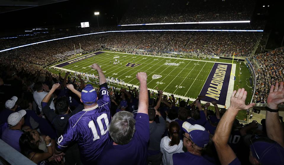 Washington fans cheer in the second half of a NCAA college football game against Boise State, in the newly renovated and re-opened Husky Stadium, Saturday, Aug. 31, 2013, in Seattle. (AP Photo/Ted S. Warren)