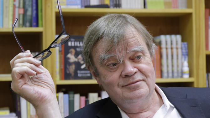 "FILE - In this April 29, 2014 Garrison Keillor pauses in his St. Paul, Minn., office. Host Garrison Keillor plans to stay home and listen to ""A Prairie Home Companion"" on the radio for a couple of shows this winter.  Keillor plans to stay home and listen to ""A Prairie Home Companion"" on the radio for a couple of shows this winter. Mandolinist Chris Thile of the band Nickel Creek will be the guest host for shows Feb. 7 and 14, 2015 from the Fitzgerald Theater in St. Paul. It's only the second time in the show's 40-year history that it's had a guest host. Singer and fiddler Sara Watkins, Thile's bandmate in Nickel Creek, hosted in 2011. (AP Photo/Ann Heisenfelt, File)"