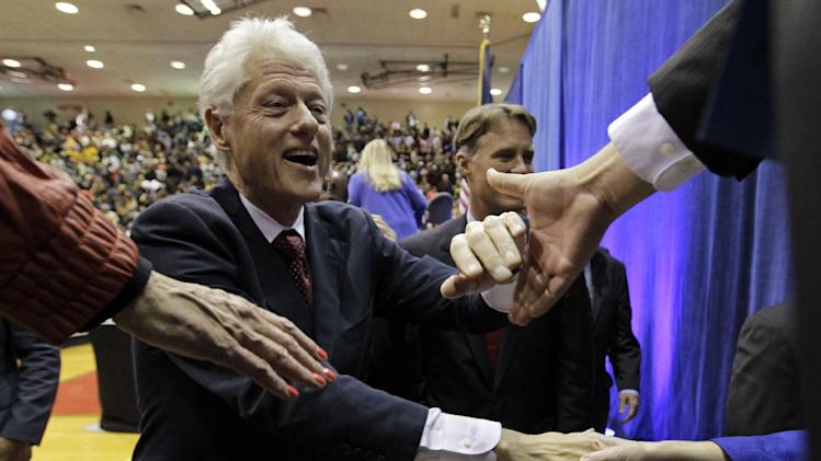 "Former President Bill Clinton shakes hands with supporters after speaking at a ""Hoosier Common Sense"" rally for Indiana Democratic Senate candidate Joe Donnelly and Democratic Indiana gubernatorial candidate John Gregg in Indianapolis, Friday, Oct. 12, 2012.  (AP Photo/Michael Conroy)"