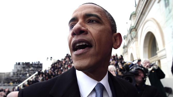 President Barack Obama greets people on the West Front of the Capitol in Washington, Monday, Jan. 21, 2013 in Washington, after his ceremonial swearing-in during the 57th Presidential Inauguration.  (AP Photo/Win McNamee, Pool)