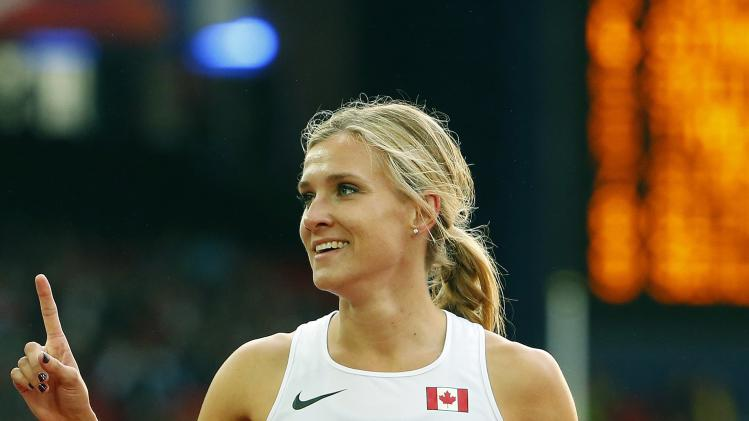 Theisen-Eaton of Canada reacts after winning gold in the heptathlon at the 2014 Commonwealth Games in Glasgow