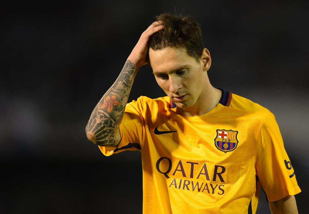 Barcelona star Messi to be tried on tax fraud charges