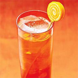 What to serve: Liven up usually clear cocktails with flavored liquor, like a Van Gogh Oranje Vodka and soda.