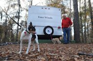 Frank Peetz stands near Sassy and Precious while camping at Lake Bistineau State Park Saturday Dec. 1, 2012 in Doyline, La. Authorities have begun moving 1 million pounds of improperly stored explosive powder to storage bunkers at the Camp Minden industrial site. State investigators found the explosives while inspecting property leased by Explo Systems, where an above-ground storage magazine exploded in October. (AP Photo/The Shreveport Times, Jim Hudelson) MAGS OUT; MANDATORY CREDIT SHREVEPORTTIMES.COM; NO SALES