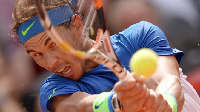 Spain's Rafael Nadal returns a ball to Italy's Fabio Fognini during their final tennis match of the ATP tennis tournament in Hamburg, Germany, August 2, 2015