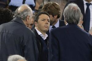 Italian Prime Minister Matteo Renzi stands on the tribune before the Italian Cup final soccer match between Fiorentina and Napoli at the Olympic stadium in Rome