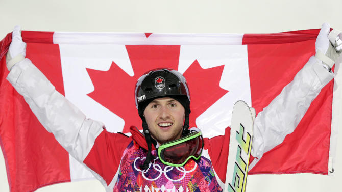 Canada's Alex Bilodeau celebrates after winning the gold medal in the men's moguls final at the 2014 Winter Olympics, Monday, Feb. 10, 2014, in Krasnaya Polyana, Russia. (AP Photo/Andy Wong)
