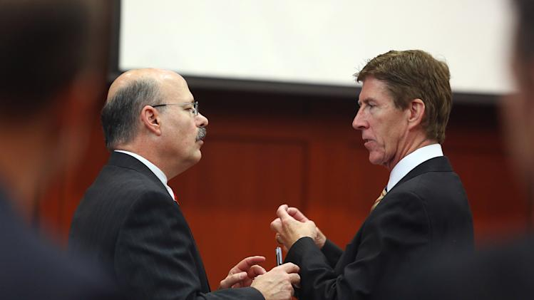 Assistant state attorney Bernie de la Rionda, left, and defense attorney Mark O'Mara, right, speak during a recess in George Zimmerman's trial in Seminole circuit court in Sanford, Fla. Wednesday, June 26, 2013. Zimmerman has been charged with second-degree murder for the 2012 shooting death of Trayvon Martin. (AP Photo/Orlando Sentinel, Jacob Langston, Pool)