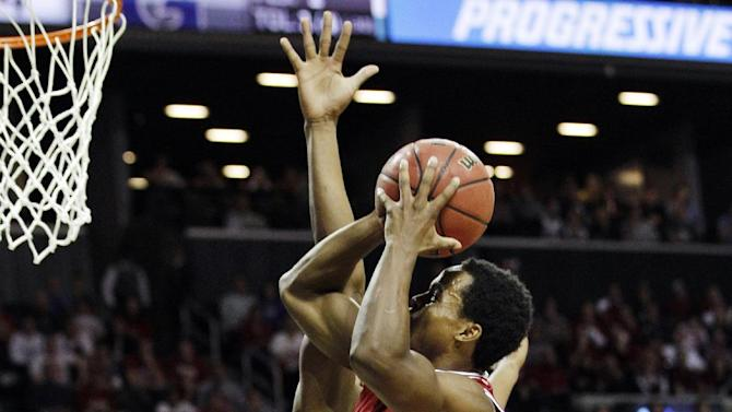 Indiana's Kevin Ferrell (11) goes up for a layup against Georgetown during the first half of their championship NCAA college basketball game at the Legends Classic at Barclays Center, Tuesday, Nov. 20, 2012, in New York. (AP Photo/Kathy Willens)